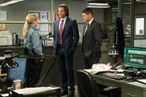 "Supernatural -- ""Plush"" -- Image SN1107B_0006.jpg -- Pictured (L-R): Briana Buckmaster as Sheriff Hanscum, Jared Padalecki as Sam and Jensen Ackles as Dean -- Photo: Liane Hentscher/The CW -- © 2015 The CW Network, LLC. All Rights Reserved."